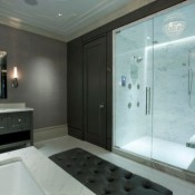 Master-bathroom-with-glass-doors-offers-visual-connectivity-with-the-bedroom